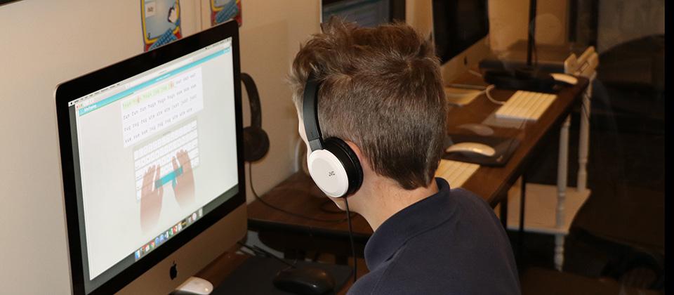 STCA student on computer image