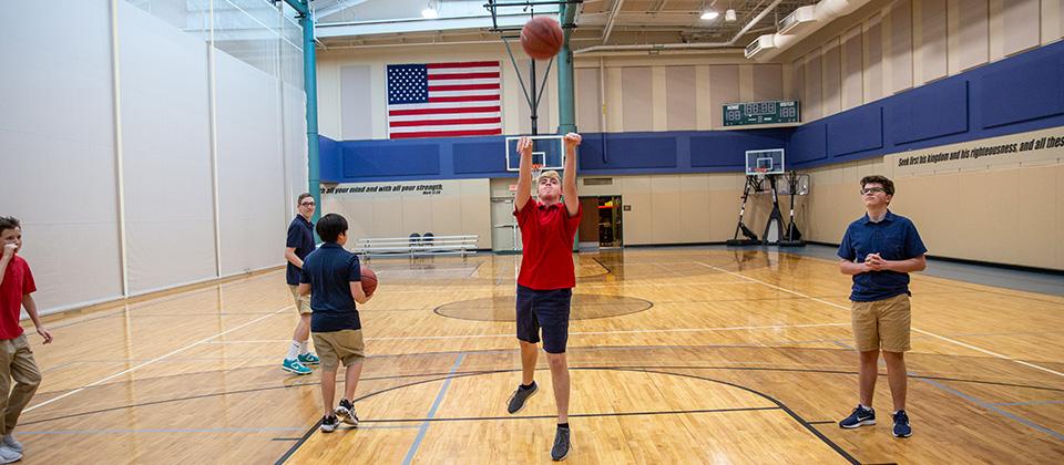 STCA student playing basketball image